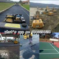Tar surfacing driveways and tennis courts