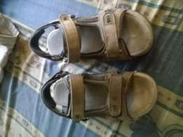 A pair of sandals for sale