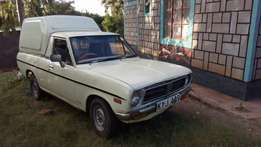 A very serviceable Datsun 1200.lady owner