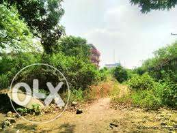 Half plot of land for sale