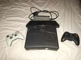Black xbox 360 slim with kinect,22 games and 2 remotes