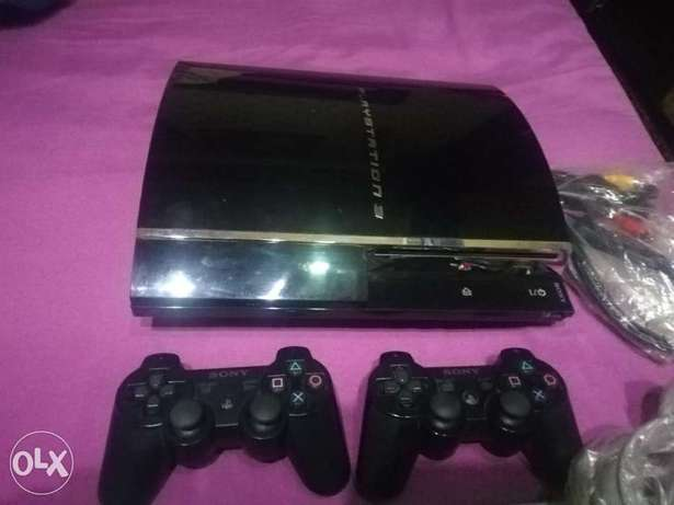 Playstation 3 fat with 2 controllers original & 4 games and all cables