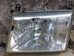 Genuine Toyota Land Cruiser VX headlight (J100) - Passenger side