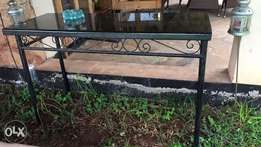 Bar table for garden or outdoor use .has a granite top black in color(