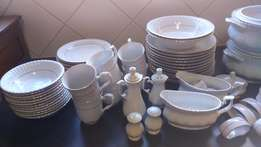 White dinner service with gold trim