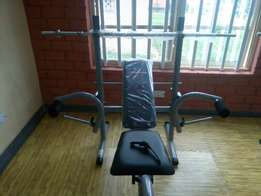 Weight bench with 50kg dumbbell plant