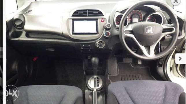 2011 model Honda Fit Silver, white n black all KCP number Mombasa Island - image 8