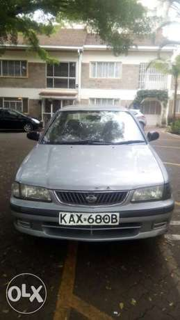 Selling Above Nissan Sunny B15, KAX 680B,Silver in Colour,Very Clean Langata - image 1