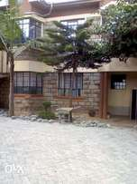 Three bedroom masterensuit in a compound of four to let in utawala 33k