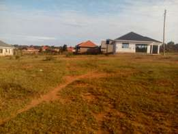 100x100 feet plot on sale at mpala bubuli with new Entebbe express on