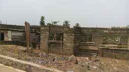 Uncompleted Bungalow of 2 flats and big land space with CofO at Orogun
