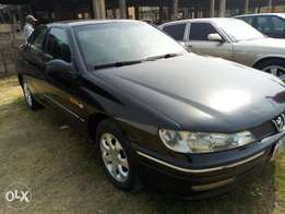 peugeot 406, with Ew10 engine, fabric seats, manual Gear. 900k