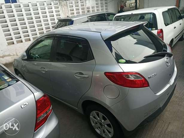 2010 model silver and black Mazda Demio for sale KCP number Mombasa Island - image 1
