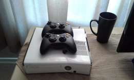 Xbox 360 6gig plus 2 remotes and 3 games