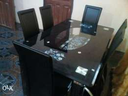 New padded six seater glass dining table
