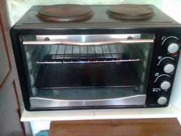 Two plate oven and 74 cm tv