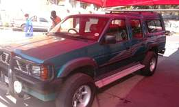 Nissan Hard body D/C V6 4X4 with Canopy