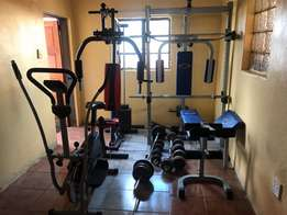full complete home gym with lotsa of bars and weights