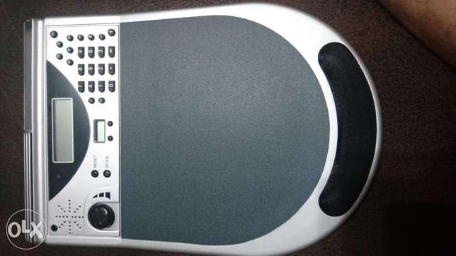 Mouse pad with auto scan FM radio, Calculator, and digital Clock
