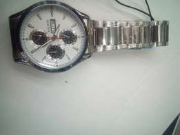 Day and date display watches