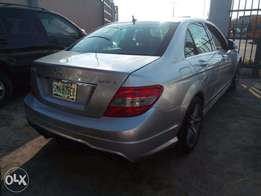 super clean benz c300 with pop up screen 2010 model
