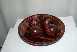 Brown patterned bowl with 'eggs' table decor