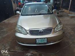 A very clean gold color toyota corolla, first body, Ac chilling, Alloy