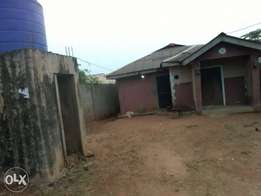 A house 2 bedroom and a room self contain for sale