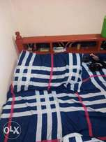 wooden bed for sale 1 month old