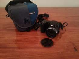 Nikon Coolpix L330 with carrier bag