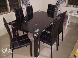 Upmarket glass dinning table..