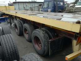12M flat deck tri axle trailer