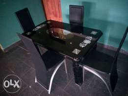 Four sitter dining table & chairs