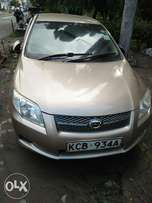 Toyota Axio gold colour fully loaded.