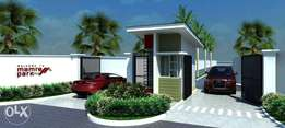 Get plots of land in an Already habitable estate gated and fenced.