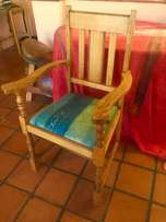 Light brown beach wood upright chair with arms and sea blue cushion