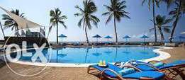 Modern executive 2 bedroom Beach side apartment with pool