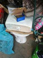Toilet pot and cistern wth pipes