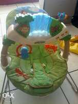 Fisher Price vibrating and musical bouncing chair