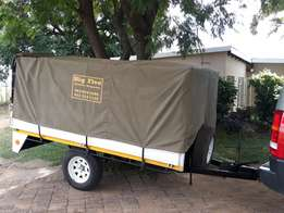 Trailer with rails and canvas cover
