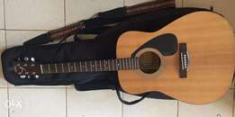 Yamaha F310 Acoustic guitar with carry bag, strap, electric pick