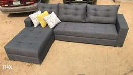 Light Grey Five Seater Sectional With Popping Throw Pillows..