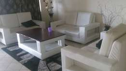 Leather seats and central table on sale. Accommodates 10 people