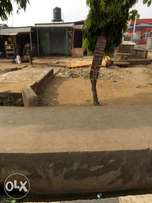 Pieces of Land with 2shop Good for carwash along Igando rd For Sale