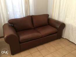 Two seater leather couch for sale