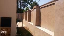 Brick walls extended plastered and repairs. New boundary walls