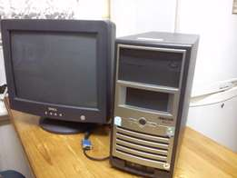 Pc tower with monitor.