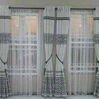 Window curtains , rings design.