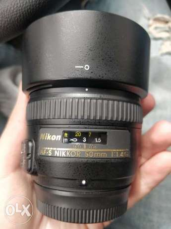 Nikon lens 50 F1.4 like new used only 4 times