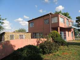 4 Bedroom house with 1 bedroom flat for sale in Warden Free state.